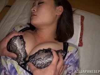 Naughty Japanese babe with big natural tits enjoying a fantastic threesome